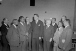 Theodore McKeldin (fifth from left) shaking hands with Martin Jenkins (third from left), President of Morgan State College. Paul Henderson, December 1950. MdHS, HEN.00.B1-073.