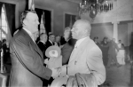Theodore McKeldin shaking hands with Marse Callaway at unidentified event. circa 1951. Paul Henderson, HEN.00.B1-091.